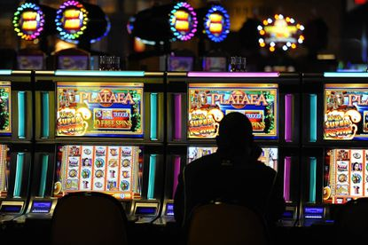 Slots players are shown at Hollywood Casino Perryville.
