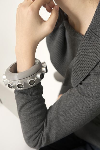 """This bracelet, a cuff with spiky transducers, has 24 speakers that emit ultrasonic signals when the wearer turns it on. Ben Zhao and Heather Zheng, both computer science professors at the University of Chicago, along with the help of assistant prof Pedro Lopes, designed this """"bracelet of silence"""" that will jam an Echo or Alexa or any other microphones in the vicinity from listening in on the wearer's conversations."""