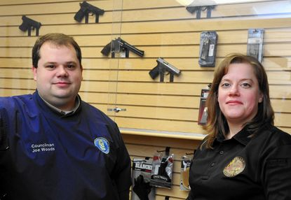 Harford County Councilman Joe Woods and his wife, Laura, are shown in her Maryland Quartermaster store in Bel Air. Joe Woods says he's occasionally worn a licensed handgun to council meetings.