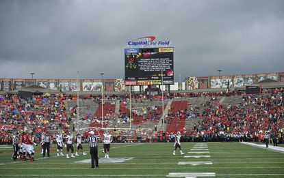 The scoreboard warns of lightning in the area late in the first half ofafootball game between Maryland and Bowling Green, Saturday, Sept. 12, 2015, in College Park, Md.