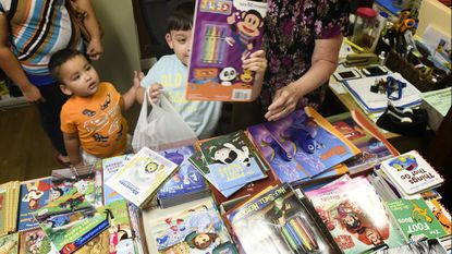 Kids pick out books during The Shepherd's Staff's Back to School Program in Westminster in 2015. This year, people can sign up for the program through July 20. Donations can be made through July 23.