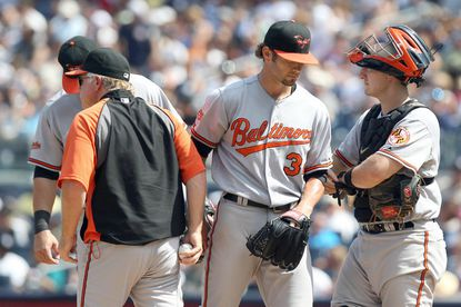 Orioles starter Jake Arrieta, center, flanked by manager Buck Showalter and catcher Craig Tatum, is removed from the game in the sixth inning. Arrieta went five-plus innings, allowing four runs (two earned) on five hits and a career-high six walks against the Yankees. He struck out four.