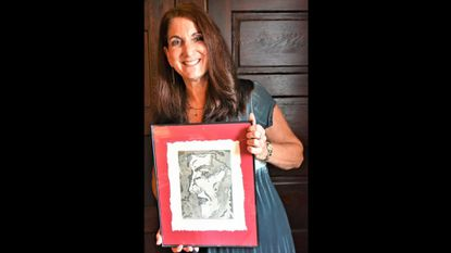 """South Carroll High School Art Department chair Lisa Katz is pictured with her aquatint titled """"Contemplation."""""""
