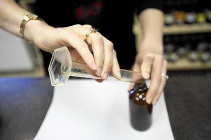 Donna Koczaja formulates a herbal tincture at the Maryland University of Integrative Health's herbal dispensary.