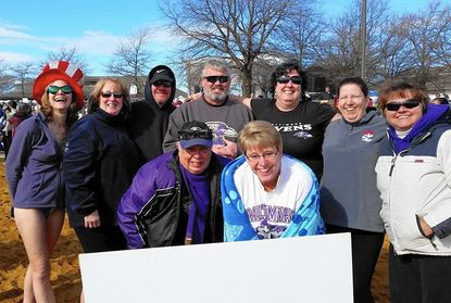 Members of Ravens Roost #100, a Baltimore Ravens fan club, raised $8,000 this year for Special Olympics Maryland through their participation in the Jan.30 Polar Bear Plunge, at Sandy Point State Park, near Annapolis. In the back row, from left, are: Teresa Funk, Barbie Barker, Chris Rogers, Kathy De Antonio, Sharon Connelly and Karen Grady. In the front row, from left, are: Guy De Antonio and Barb Duvall