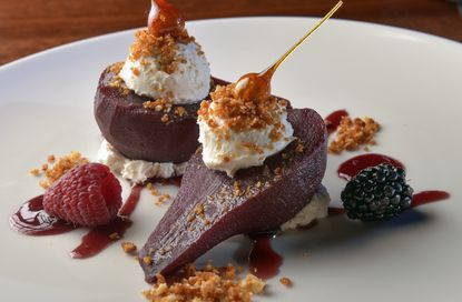 Red-wine poached pears prepared by Iron Bridge Wine Co. executive chef Tyler Skinner.