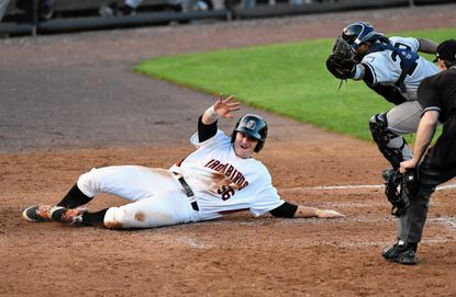 Aberdeen's Steve Laurino slides safely into home avoiding the tag during the first game of Friday's doubleheader against Staten Island at Ripken Stadium.