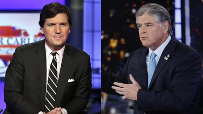 Fox News hosts Tucker Carlson and Sean Hannity in a 2017 file photo.