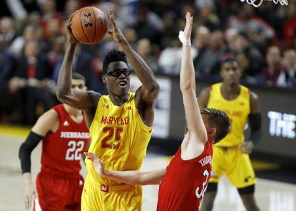 Maryland forward Jalen Smith (25) goes up for a shot against Nebraska guard Thorir Thorbjarnarson (34) during the first half of an NCAA college basketball game, Tuesday, Feb. 11, 2020, in College Park, Md.