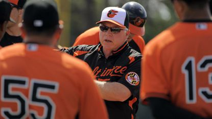Orioles manager Buck Showalter talks to players during last year's spring training in Sarasota, Fla.