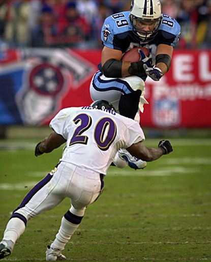 Tight end Frank Wycheck tries to evade Ravens safety Kim Herring. Wycheck was selected by the Washington Redskins in the sixth round of the 1993 draft. Wycheck also played for the Houston Oilers/Tennessee Titans, retiring in 2003. Wycheck is one of only five tight ends to have amassed 500 career receptions in the NFL. He led Maryland with 58 catches in 1990.
