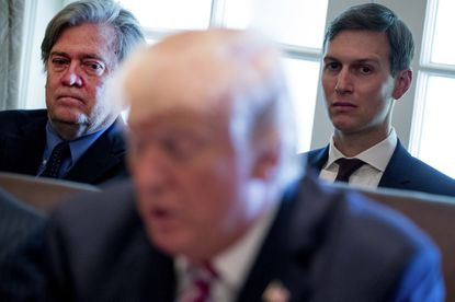 Steve Bannon, left, and Jared Kushner, listen as President Donald Trump speaks during a Cabinet meeting at the White House in Washington, D.C. on June 12, 2017.