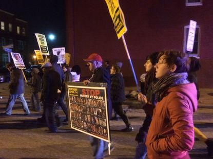 Protesters demanding justice for Tamir Rice and Sandra Bland march down Greenmount Avenue.