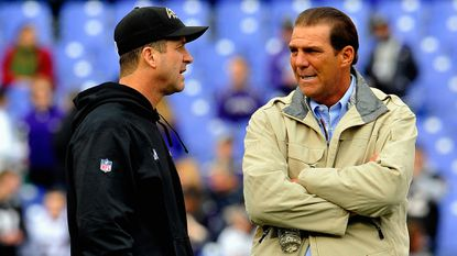 Ravens coach John Harbaugh, left, and owner Steve Bisciotti talk before the regular-season finale against the Cleveland Browns at M&T Bank Stadium.