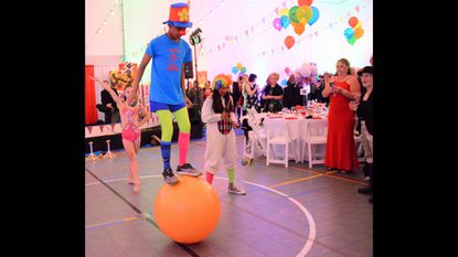 "Ajaya Curtis balances on a ball during the 2018 Legacy Gala at the Historical Society of Carroll County. The theme was ""Come to the Circus."""