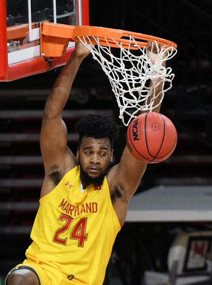 Donta Scott, Terps, watches the ball drop as he holds on to the rim in the 1st half as the University of Maryland men's basketball team hosts Wingate at the Xfinity Center. The Terps play Division II Wingate after the game against Nebraska was postponed because of COVID-19 cases in the Nebraska program. January 15, 2021.