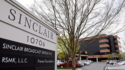 <p>The Justice Department is examinging whether communciations between broadcasters including Sinclair Broadcast Group and Tribune Media violated antitrust laws.</p>