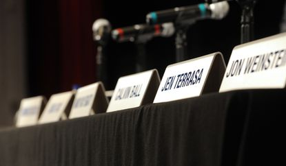 Place cards are set up on a table at the ceremony where the new Howard County Council would hold their first session after taking their oaths of office Monday, Dec. 1, 2014 at Glenelg High School in Glenelg.