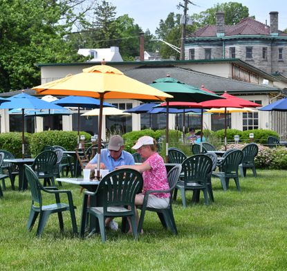 Tidewater Grille customers Keith and Janice Weller of Havre de Grace enjoy some lunch in the outdoor dining area Wednesday afternoon. Many restaurants in Havre de Grace are open for outdoor dining and following the county and state guidelines for coronavirus safety.