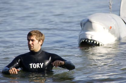 """Tory Belleci demonstrates the power of a shark's bite for an episode of """"Mythbusters"""" in 2008."""