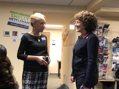 Dr. Leslie Grant, a 7th Congressional District candidate, chats with Del. Shelly Hettleman at a meeting of the Baltimore County Democratic Central Committee earlier this week. Gov. Larry Hogan appointed Hettleman to a vacant seat in the state Senate on Thursday after she was recommended for the position by the Democratic committee.