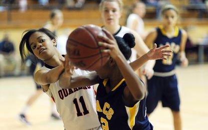 Friends guard Alexis Heath, left, attempts to steal the ball from Annapolis Area Christian School's Jaida Molden during the Eagles' 40-30 win Wednesday.