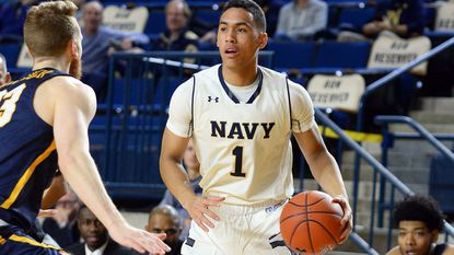Navy's John Carter Jr. moves the ball in the first half against visiting Coppin State at Alumni Hall.
