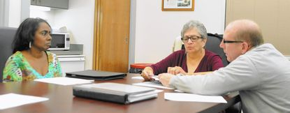 Aberdeen Board of Elections members, from left, Angela Johnson, Gina Bantum and Mark Schlottman review an untimely absentee ballot, which they rejected, during a special meeting Wednesday. The trio says it wants the mayor and city council to authorize a special election to break a stalemate over the seating of a fourth council member.