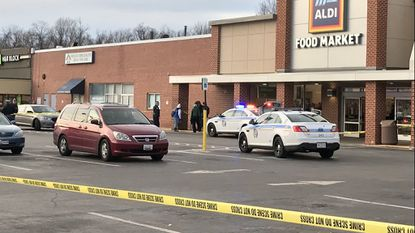 Baltimore County Police said Thursday that Officers First Class Sands and Waugh shot and killed 24-year-old Emanuel David Oates on Tuesday afternoon at the Aldi grocery store in the 8600 block of Liberty Road in Randallstown.