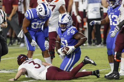 Duke defensive end Victor Dimukeje (51) recovers a fumble by Virginia Tech quarterback Braxton Burmeister during a game Oct. 3, 2020, in Durham, N.C.