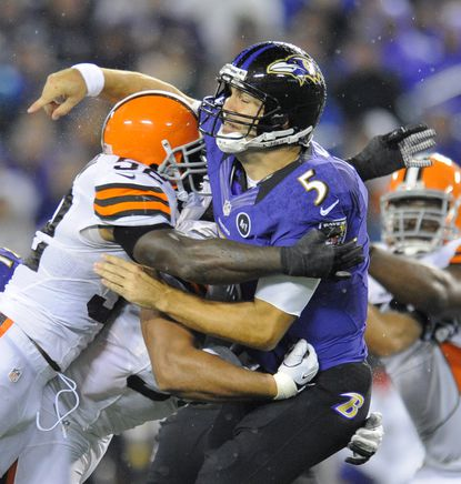 Joe Flacco is hit by D'Qwell Jackson in the second quarter.