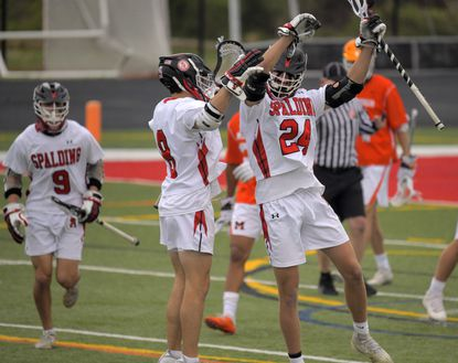 Spalding midfielders Michael Weisshaar (8) and Wil Duffy (24) celebrate a goal by Duffy against McDonogh on April 9. The Cavaliers beat Gilman on Friday afternoon to improve to 6-1 on the season.