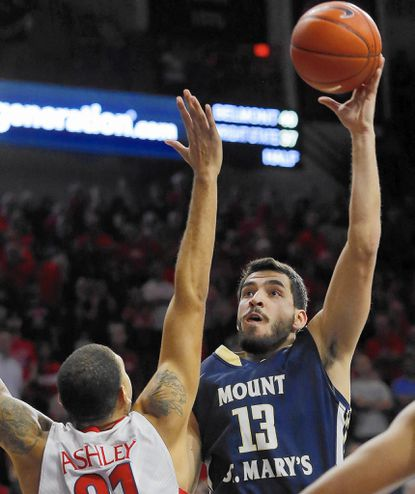 Mount St. Mary's forward Kristijan Krajina (13) shoots over Arizona forward Brandon Ashley during the first half of an NCAA college basketball game, Friday, Nov. 14, 2014, in Tucson, Ariz. (AP Photo/Rick Scuteri) ** Usable by LA, DC, CGT and CCT Only **