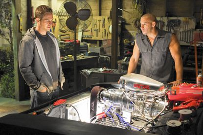 "The late Paul Walker and Vin Diesel reapprise their roles from the ""Fast and Furious"" series in the upcoming ""Furious 7"" directed by James Wan. Walker and Diesel are pictured here in this publicity still from ""Fast and Furious."" (AP Photo/Universal Pictures, Jaimie Trueblood)"
