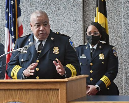Baltimore Police Commissioner Michael Harrison, left, announces changes in the department's top leadership at a March news conference.