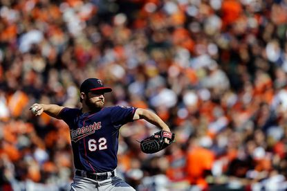 Starting pitcher Liam Hendriks, then with the Twins, throws to the Orioles during Baltimore's 2013 home opener on April 5 in Baltimore.