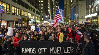 People marched through Times Square during a protest on Nov. 8, the day after President Donald Trump forced the resignation of Attorney General Jeff Sessions. Trump dismissed Sessions putting the future of Special Counsel Robert Mueller's Russia investigation in jeopardy.