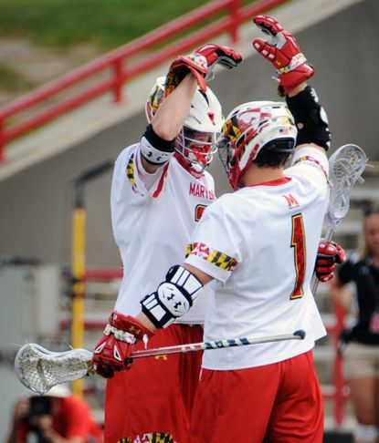 Maryland's Colin Heacock, left, celebrates a goal with teammate Matt Rambo last season.