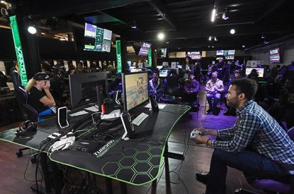 "Local gamer ""Logic"" Anthony Moorman, right, of Owings Mills, beats Taylor Rose, left, of South Florida, in a Smash 4 Ultimate weekly tournament at Xanadu Games at Laurel Park."
