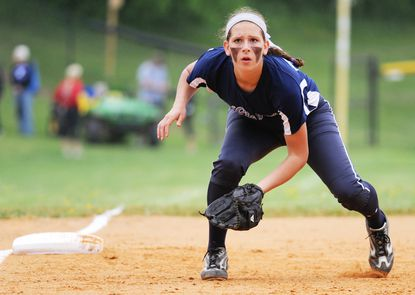 Howard's Berit Batterton prepares for a hit to come in her direction during a regional playoff game at Sherwood.