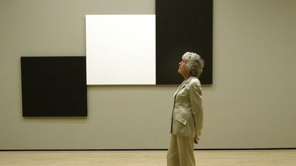 """Suzanne Cohen gave the Baltimore Museum of Art $1 million to enable the museum to offer free admission. The painting in the backgrund is Ellsworth Kelly's """"Two Blacks and White."""""""