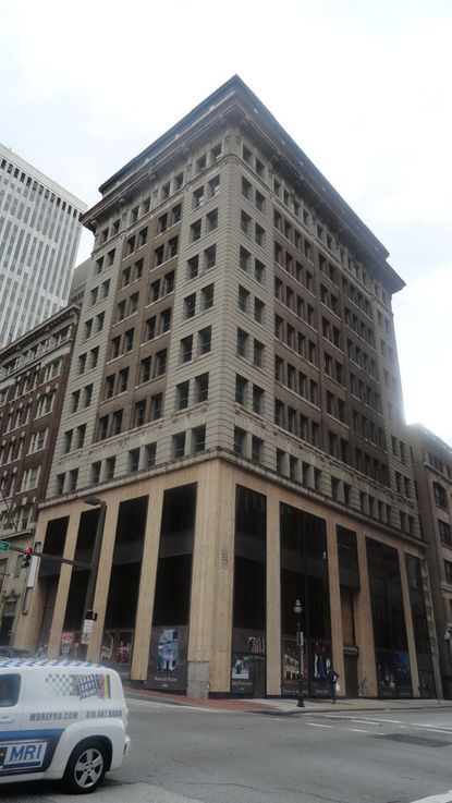 Rialto Capital Management wants to sell the 1884 building at 101 N. Charles Street, which has been partially converted to a hotel.