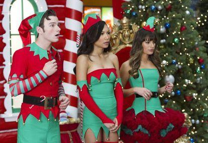 "Kurt (Chris Colfer, L), Santana (Naya Rivera, C) and Rachel (Lea Michele, R) work as Santa's elves at a mall on ""Glee."""