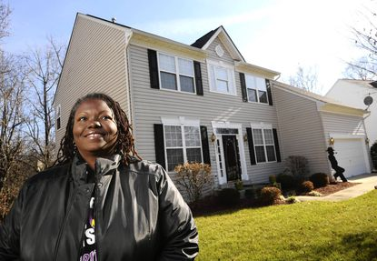 Deatrice S. Besong is pictured at her home in Upper Marlboro. Bank of America, her servicer, has agreed to reduce her mortgage principal.