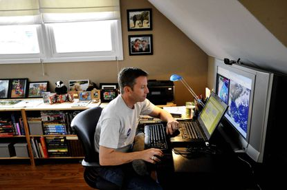 Rob Gutro, deputy news chief and meteorologist at Goddard Space Flight Center telecommutes from his home in Bowie three days a week.