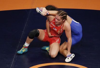Helen Maroulis, front wrestles Irina Ologonova of Russia during their women's freestyle gold-medal match at the wrestling world championships Thursday night in Las Vegas.