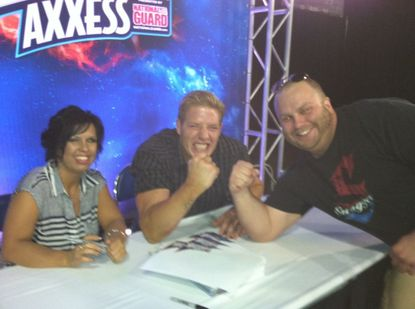 Guest writer Mike LaFleur at WrestleMania Axxess poses with former World Champion Jack Swagger and Vickie Guerrero.