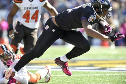 Ravens wide receiver Darren Waller (12) struggles to get away from Browns defensive back Joe Haden (23) and to the line of scrimmage on Oct. 10, 2015.