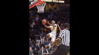 Gators #15 Tyler Holley scores as Perry Hall beats the Bladensburg Mustangs in the 4A boys basketball state championship game at the Xfinity Center in College Park.