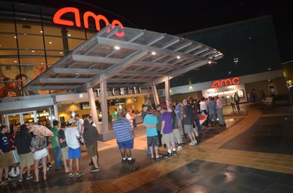 """Crowds lined up at the AMC Columbia for the midnight showing of """"The Dark Knight Rises"""" in 2012."""